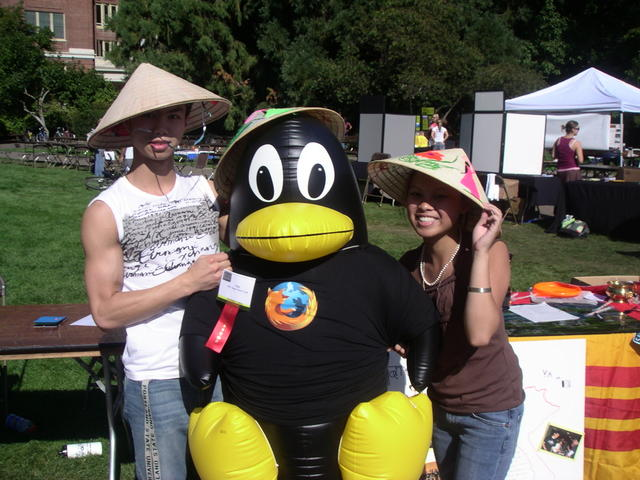 Tux and a rice hat